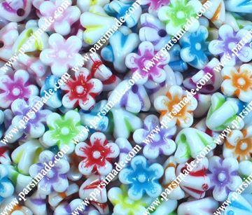 تصویر دکمه تزئینی پلاستیکی طرح گل